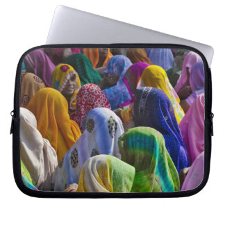 Women in colorful saris gather together laptop computer sleeve