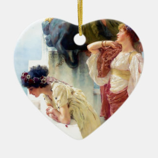 Women looking at water painting ceramic heart decoration