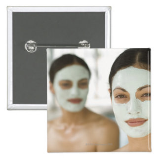 Women smiling in beauty mud masks 15 cm square badge