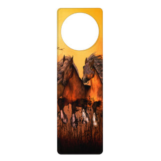 Wonderful horses running by a forest door hanger