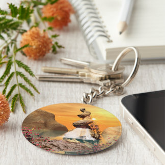 Wonderful view over the sea to the rock basic round button key ring