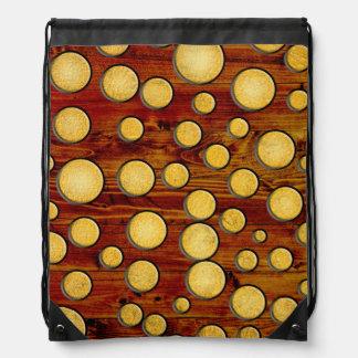Wood and gold drawstring bag