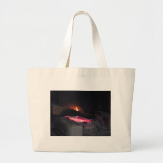 Wood fire flame heat spires burning in fireplace large tote bag