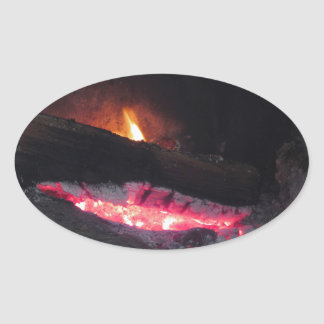 Wood fire flame heat spires burning in fireplace oval sticker
