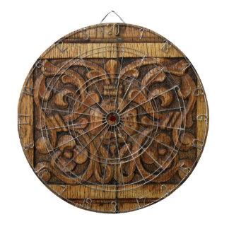 wood panel dartboard with darts
