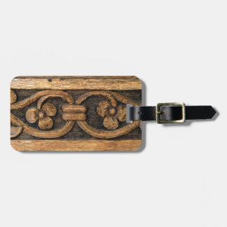 wood panel sculpture luggage tag