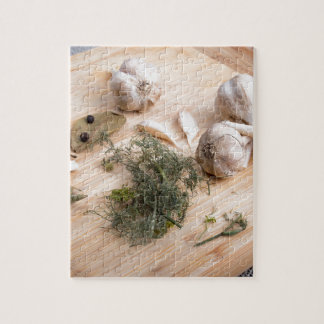 Wooden board with garlic and dried spices closeup jigsaw puzzle