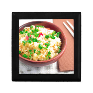 Wooden bowl of cooked rice and leek gift box