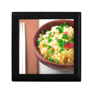 Wooden bowl of cooked rice and vegetables gift box
