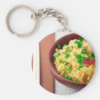 Wooden bowl of cooked rice and vegetables key ring