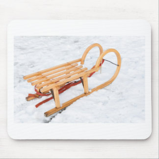 Wooden children sled in winter snow mouse pad