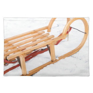 Wooden children sled in winter snow placemat