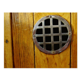 Wooden door with metal grill postcard