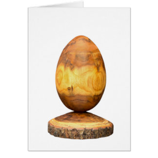 Wooden egg made of acacia tree with bark. card