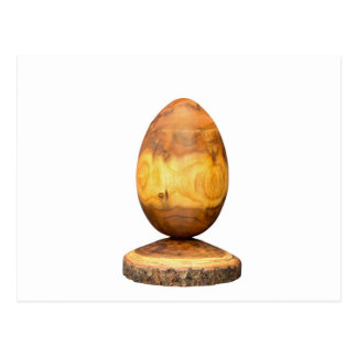Wooden egg made of acacia tree with bark. postcard