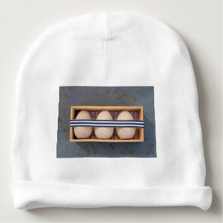 Wooden eggs in a box baby beanie