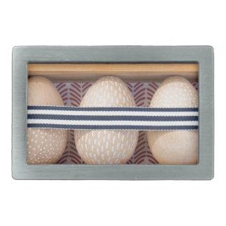 Wooden eggs in a box belt buckles