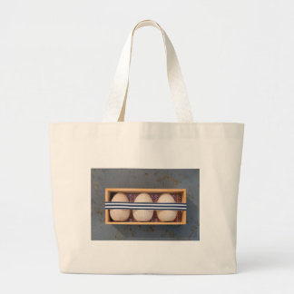 Wooden eggs in a box large tote bag