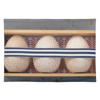Wooden eggs in a box placemat