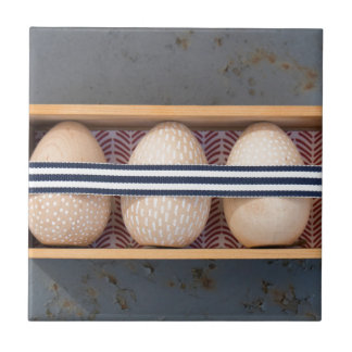 Wooden eggs in a box tile