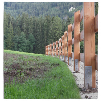 Wooden fence with forest in the background cloth napkin