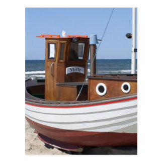 Wooden fishing boat on the beach. postcard