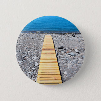 Wooden footpath on beach leading to portuguese sea 6 cm round badge