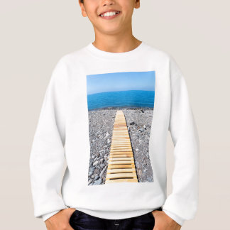 Wooden footpath on beach leading to portuguese sea sweatshirt