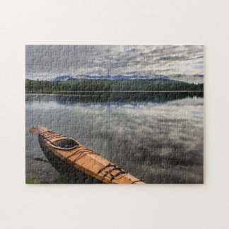 Wooden kayak on shore of Beaver Lake Puzzle