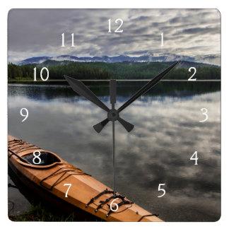 Wooden kayak on shore of Beaver Lake Square Wall Clock
