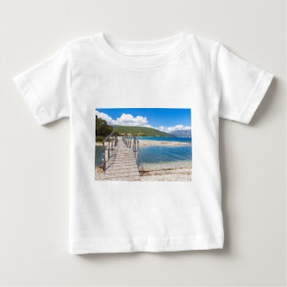 Wooden pedestrian bridge on greek beach baby T-Shirt
