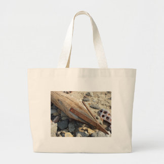 Wooden pole with an iron spike on the construction jumbo tote bag