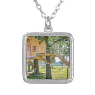 Wooden tree house in oak tree with grass silver plated necklace