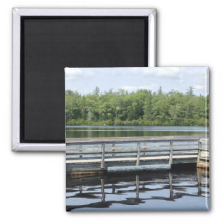 wooden wharf water reflections nature magnet