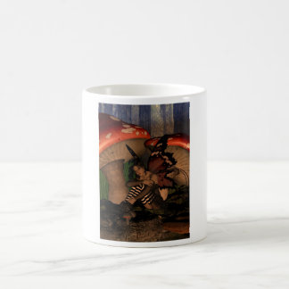 Woodland fairy under mushrooms coffee mug
