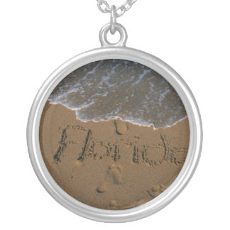 Word Florida in beach sand with wave coming Silver Plated Necklace