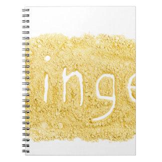 Word Ginger written in spice powder Notebook