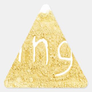 Word Ginger written in spice powder Triangle Sticker