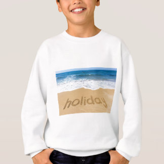 Word holiday written in sand on beach sweatshirt