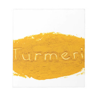 Word Turmeric written in powder on white backgroun Notepad