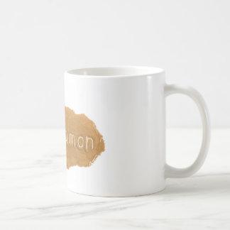 Word written in Cinnamon powder on white backgroun Coffee Mug