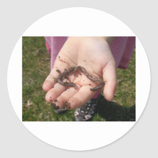 worms in childs hands classic round sticker