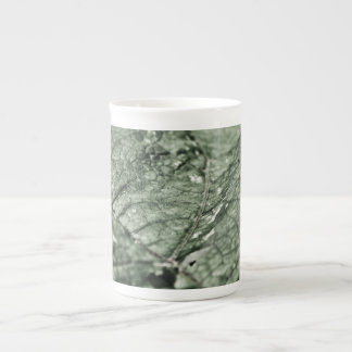 Worn green leaf bone china mug