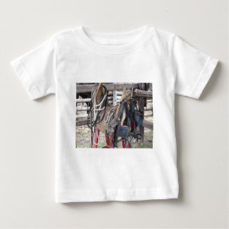 Worn leather horse bridles and bits baby T-Shirt