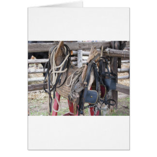 Worn leather horse bridles and bits card