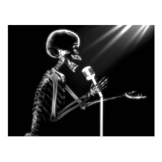 X-RAY SKELETON SINGING ON RETRO MIC - B&W POSTCARD