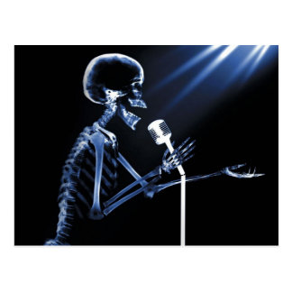 X-RAY SKELETON SINGING ON RETRO MIC - BLUE POSTCARD