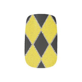 Yellow and black diamond nail art