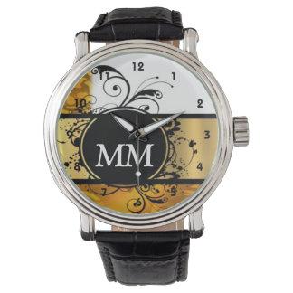 Yellow and black monogram on white wristwatch