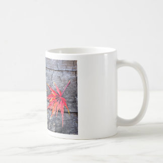 Yellow and red maple leaf on black burnt wood coffee mug
